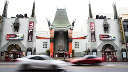 HOLLYWOOD, CALIFORNIA - MARCH 13: Visitors to the TCL Chinese Theatre are seen on March 13, 2020 in Hollywood, California. The spread of COVID-19 has negatively affected a wide range of industries all across the global economy. (Photo by Rich Fury/Getty Images)