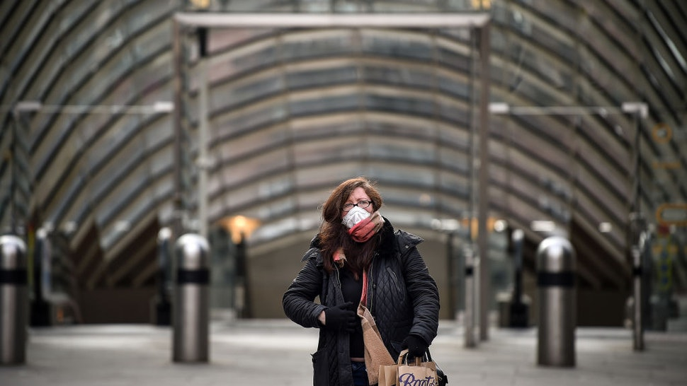A woman wears a mask outside St Enoch subway station on March 21, 2020 in Glasgow, Scotland. Coronavirus (COVID-19) has spread to at least 182 countries, claiming over 10,000 lives and infecting more than 250,000 people.