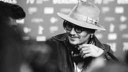 """Johnny Depp speaks at the """"Minamata"""" press conference during the 70th Berlinale International Film Festival Berlin at Grand Hyatt Hotel on February 21, 2020 in Berlin, Germany."""