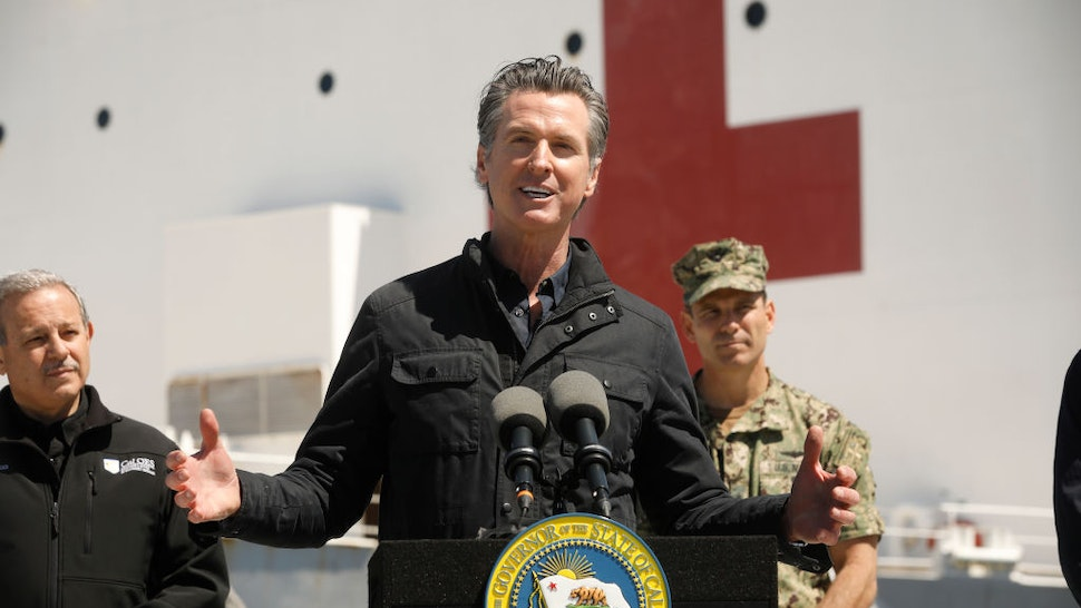 California Governor Gavin Newsom speaks in front of the hospital ship USNS Mercy that arrived into the Port of Los Angeles on Friday, March 27, 2020, to provide relief for Southland hospitals overwhelmed by the coronavirus pandemic.