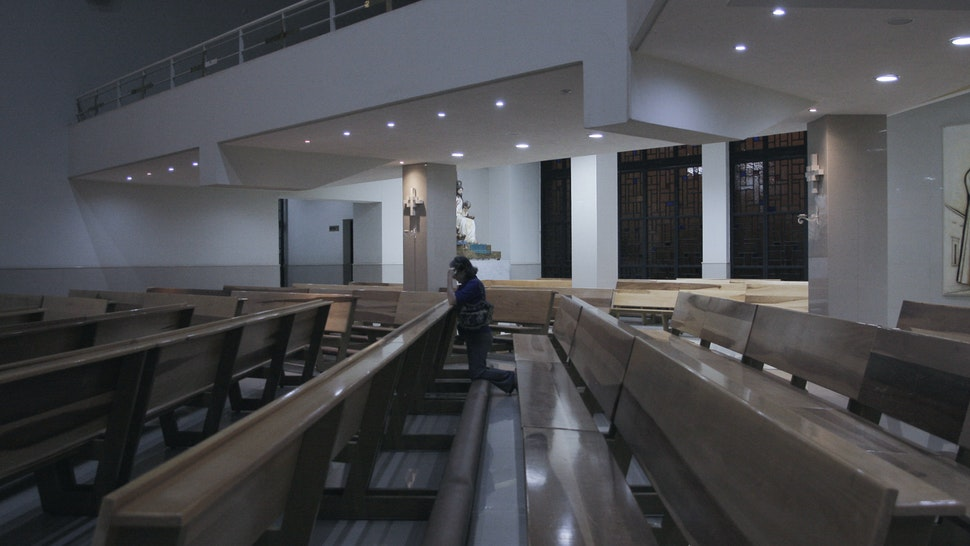 GUADALAJARA, MEXICO - MARCH 27: A woman prays in a empty church on March 27, 2020 in Guadalajara City, Mexico. While most countries and major cities have ordered a lockdown to halt COVID-19 spread, Mexican president Lopez Obrador has not called for national quarantine yet. His critics argue he downplays on coronavirus threat as he seek to protect the economy. In Guadalajara, measures to avoid the spread of the COVID-19 have been taken, schools of all levels are closed since March 16, business around the city must shut down and many tests will be taken in people suspected to be infected. 81 cases have been confirmed in Mexican State of Jalisco. (Photo by Leonardo Alvarez Hernandez/Getty Images)