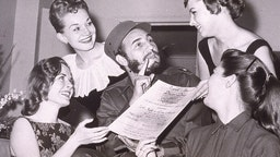 Cuban leader Fidel Castro is presented with an invitation to the New York Press Photographer's Ball, New York City,