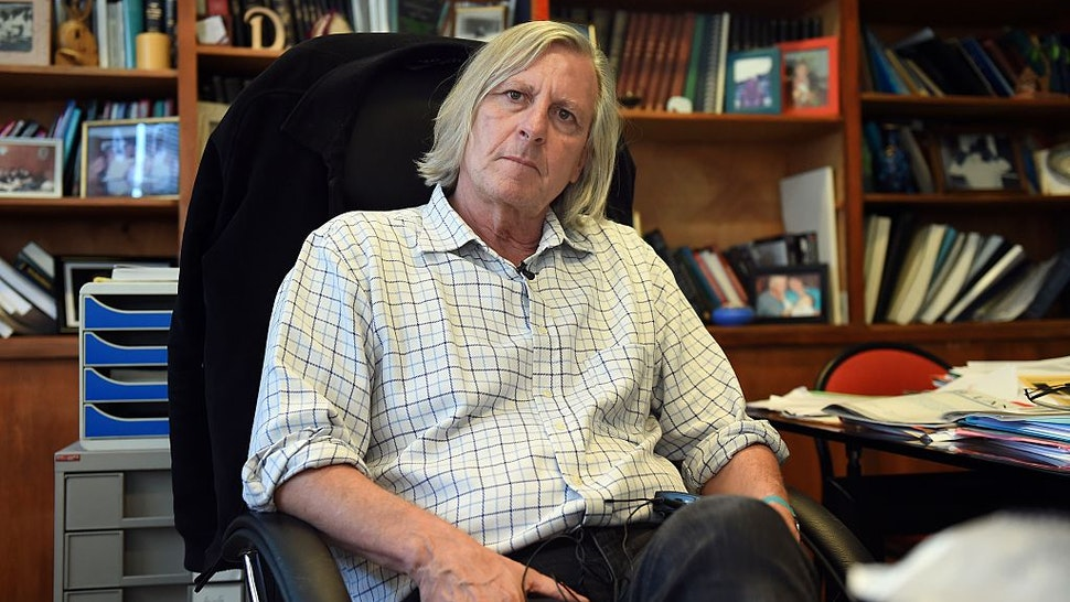 Didier Raoult, Professor at the Faculty of Medicine of Marseille, poses on November 6, 2014 in his office at the Facutly of Medicine in Marseille, southern France.