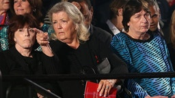 Three of the four woman who sat with Donald Trump in a press conference and made several accusations against Bill and Hillary Clinton -- Kathleen Wiley (left), Juanita Broaddrick (center), and Kathy Shelton -- attend the presidential debate on Sunday, Oct. 9, 2016 at Washington University in St. Louis, Mo.