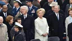 Former Us President Bill Clinton(L), former US President Jimmy Carter(L) former US President George W. Bush(2ndR) and Hillary Clinton(C) arrive on the platform of the US Capitol in Washington, DC, on January 20, 2017,