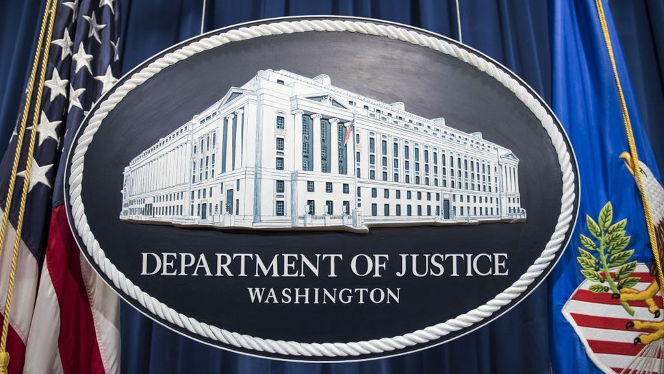 The Department of Justice logo hangs as the backdrop before a press conference held by Attorney General Jeff Sessions on leaks of classified material threatening national security in Washington, USA on August 4, 2017.