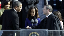 Barack H. Obama shakes the hand of Chief Justice John Roberts after his swearing in as the 44th president of the United Statesas on the West Front of the Capitol as his wife Michelle looks on January 20, 2009 in Washington, DC.