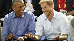 Former U.S. President Barack Obama and Prince Harry share a joke as they watch wheelchair baskeball on day 7 of the Invictus Games 2017 on September 29, 2017 in Toronto, Canada