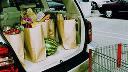 Groceries in back of car, parked in parking lot