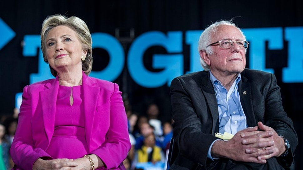 RALEIGH, NC - Democratic Nominee for President of the United States former Secretary of State Hillary Clinton, with Senator Bernie Sanders (I-VT), speaks to and meets North Carolina voters at Coastal Credit Union Music Park at Walnut Creek during a rally in Raleigh, North Carolina Thursday November 3, 2016.