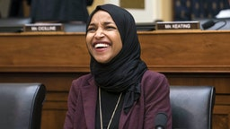 Representative Ilhan Omar, a Democrat from Minnesota, smiles following a House Foreign Affairs Committee hearing in Washington, D.C., U.S., on Friday, Feb. 28, 2020. Secretary of StateMichael Pompeodefended the Trump administration's Mideast policy and the targeted killing of Iranian GeneralQassem Soleimanilast month, as the top U.S. diplomat made a rare appearance Friday before House lawmakers.