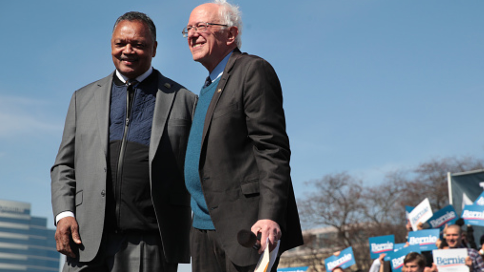 GRAND RAPIDS, MICHIGAN - MARCH 08: Democratic presidential candidate Sen. Bernie Sanders (I-VT) and Rev. Jesse Jackson greet the crowd during a campaign rally in Calder Plaza on March 08, 2020 in Grand Rapids, Michigan. Michigan holds its primary election on Tuesday March 10.