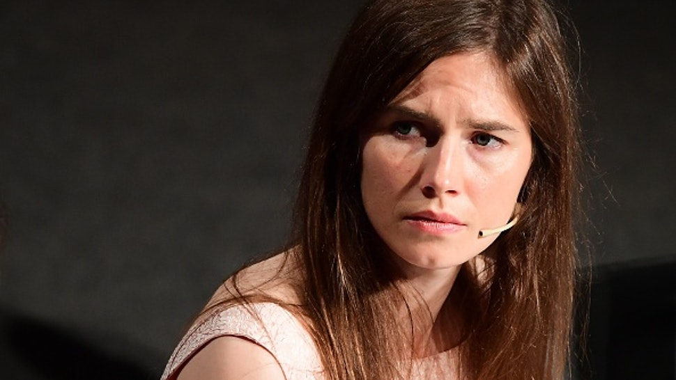 """US journalist Amanda Knox attends a panel discussion titled """"Trial by Media"""" during the Criminal Justice Festival at the Law University of Modena, northern Italy on June 15, 2019. - Knox returns to Italy for the first time since the US student was acquitted in 2015 of the gruesome killing of her British housemate after spending four years behind bars. The Seattle native, now 31, was 20-years-old at the time of the murder of Briton Meredith Kercher, a fellow exchange student whose half-naked body was found on November 2, 2007, in a bedroom of the apartment she and Knox shared in the central city of Perugia."""