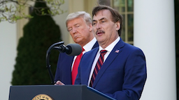 US President Donald Trump listens as Michael J. Lindell, CEO of MyPillow Inc., speaks during the daily briefing on the novel coronavirus, COVID-19, in the Rose Garden of the White House in Washington, DC, on March 30, 2020.