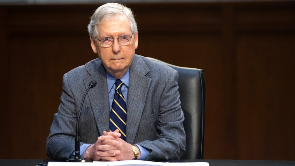 US Senate Majority Leader Mitch McConnell attends a meeting to discuss a potential economic bill in response to the coronavirus, COVID-19, in Washington, DC, on March 20, 2019. - McConnell unveiled on March 19, an economic rescue plan to send $1,200 direct checks to taxpayers, $300 billion for small businesses to keep idled workers on payroll and $208 billion in loans to airlines and other industries.