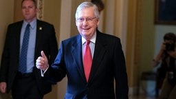 Senate Majority Leader Mitch McConnell (R-KY) leaves the US Senate floor at the US Capitol March 25, 2020, in Washington, DC. - The US Senate was poised to pass a massive relief package on Wednesday for Americans and businesses ravaged by the coronavirus pandemic as New York hospitals braced for a wave of virus patients.