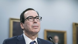 Steven Mnuchin, U.S. Treasury secretary, listens during a House Appropriations Committee hearing on Capitol Hill in Washington, D.C., U.S., on Wednesday, March 11, 2020. Mnuchin said he supports extending the 2019 tax-filing deadline beyond April 15 to provide relief from economic disruption caused by the coronavirus outbreak, and he'll recommend that step to President Donald Trump.