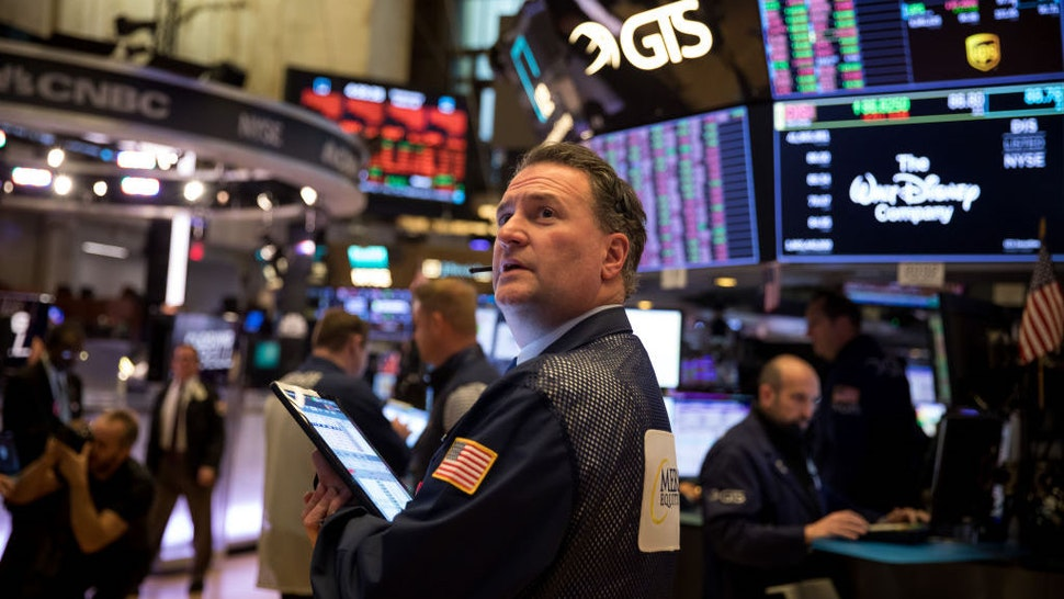 Traders work on the floor of the New York Stock Exchange in New York, the United States, March 18, 2020. U.S. equities ended Wednesday's volatile session sharply lower as panic selling continued on Wall Street amid coronavirus fears. The Dow Jones Industrial Average decreased 1,338.46 points, or 6.30 percent, to 19,898.92, marking its first close below 20,000 since February 2017. The 30-stock index cratered more than 2,300 points at session lows. (Photo by Michael Nagle/Xinhua via Getty)