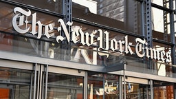 """The New York Times building is seen on September 6, 2018 in New York. - A furious Donald Trump called September 5, 2018 for the unmasking of an anonymous senior official who wrote in the New York Times that top members of his administration were undermining the president to curb his """"misguided impulses."""" Trump asked if the unsigned op-ed could be considered treasonous, assailed the newspaper for the """"gutless"""" piece and questioned whether the senior official it was attributed to actually existed. """"TREASON?"""" Trump posted in response to the article entitled """"I Am Part of the Resistance Inside the Trump Administration,"""" which claimed the president's own staff see him as a danger to the nation.""""Does the so-called 'Senior Administration Official' really exist, or is"""