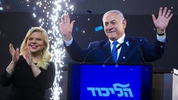 TEL AVIV, ISRAEL - APRIL 10: Prime Minster of Israel, Benjamin Netanyahu and his wife, Sara greet supporters during his after vote speech on April 10, 2019 in Tel Aviv, Israel. Prime Minister Benjamin Netanyahu and Blue and White leader Benny Gantz each declared that they won Tuesday's election after inconclusive exit polls were broadcast on the three Israeli networks.