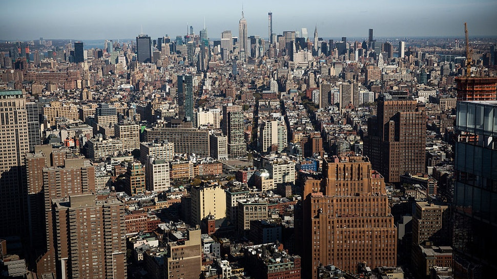 NEW YORK, NY - NOVEMBER 03: The view from the 63rd floor of One World Trade Center, which opens for business today, is seen on November 3, 2014 in New York City. The skyscraper is 104 stories tall and cost $3.9 billion; it opens more than 13 years after the terrorist attacks of September 11, 2001, destroyed the original World Trade Center buildings. Officials say the building is currently at 60% occupancy, with Conde Nast as one of the first major tenants to move