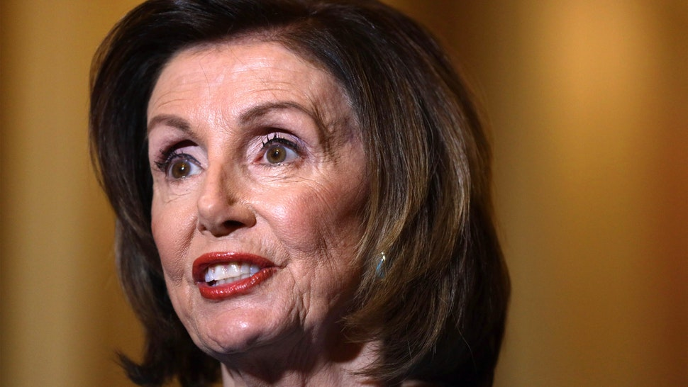 WASHINGTON, DC - MARCH 13: U.S. Speaker of the House Rep. Nancy Pelosi (D-CA) makes a statement at the U.S. Capitol March 13, 2020 in Washington, DC. Speaker Pelosi spoke on the Families First Coronavirus Response Act that the House will vote later on.