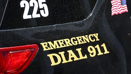 SANTA FE, NM - JULY 27, 2017: A Santa Fe, New Mexico, police car is marked with 'Emergency Dial 911' painted on its side.