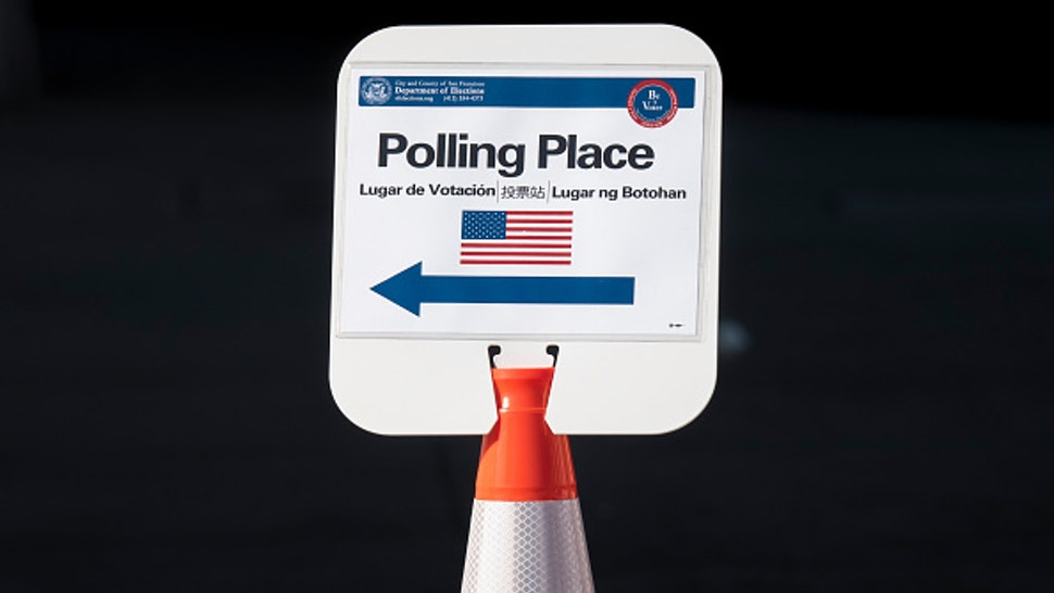 A sign stands outside a polling place in San Francisco, California, U.S., on Tuesday, March. 3, 2020. Today's primary contests, across 14 states, plus American Samoa, that will award more than a third of all delegates to the Democratic convention in July in Milwaukee, provide a key test for each of the remaining contenders. Photographer: David