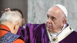 Cardinal Jozef Tomko receives the ashes on the forehead from Pope Francis during the Ash Wednesday mass which opens Lent, the forty-day period of abstinence and deprivation for Christians before Holy Week and Easter, on February 26, 2020, at the Santa Sabina church in Rome.