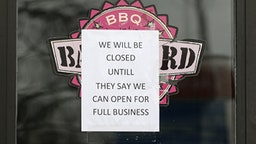 TOLEDO, OH - MARCH 24: A sign stating that a restaurant is closed is seen during the stay-at-home order issued by Ohio Gov. Mike DeWine during the coronavirus COVID-19 outbreak on March 24, 2020 in Toledo, Ohio.