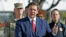 Florida Gov. Ron DeSantis talks to the media during press conference at the Broward County mobile testing at CB Smith Park in Pembroke Pines on Thursday, March 19, 2020. (David Santiago/Miami Herald/TNS)