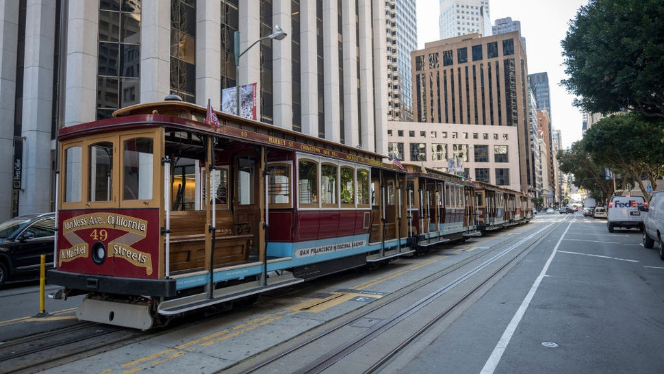 Empty cable cars stand on California Street in San Francisco, California, U.S., on Monday, March. 16, 2020. Six of the biggest counties in the San Francisco Bay Area ordered people to stay home except for essential needs, marking one of the nation's strongest local efforts yet to stem the spread of the coronavirus. Photographer: David Paul Morris/Bloomberg