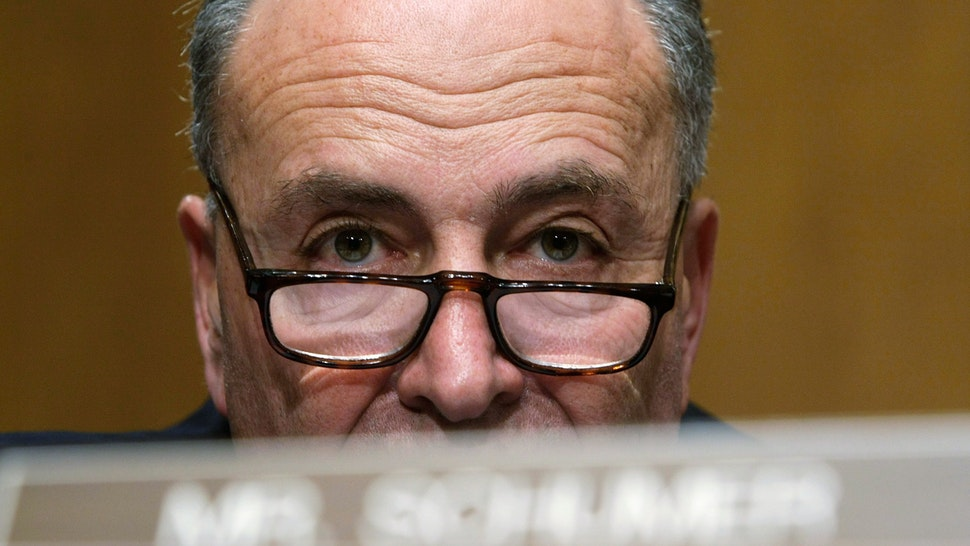 """WASHINGTON - NOVEMBER 13: U.S. Sen. Charles Schumer (D-NY) listens during a hearing before the Senate Banking, Housing and Urban Affairs Committee on Capitol Hill November 13, 2008 in Washington, DC. The hearing was focused on """"Oversight of the Emergency Economic Stabilization Act: Examining Financial Institution Use of Funding Under the Capital Purchase Program."""""""