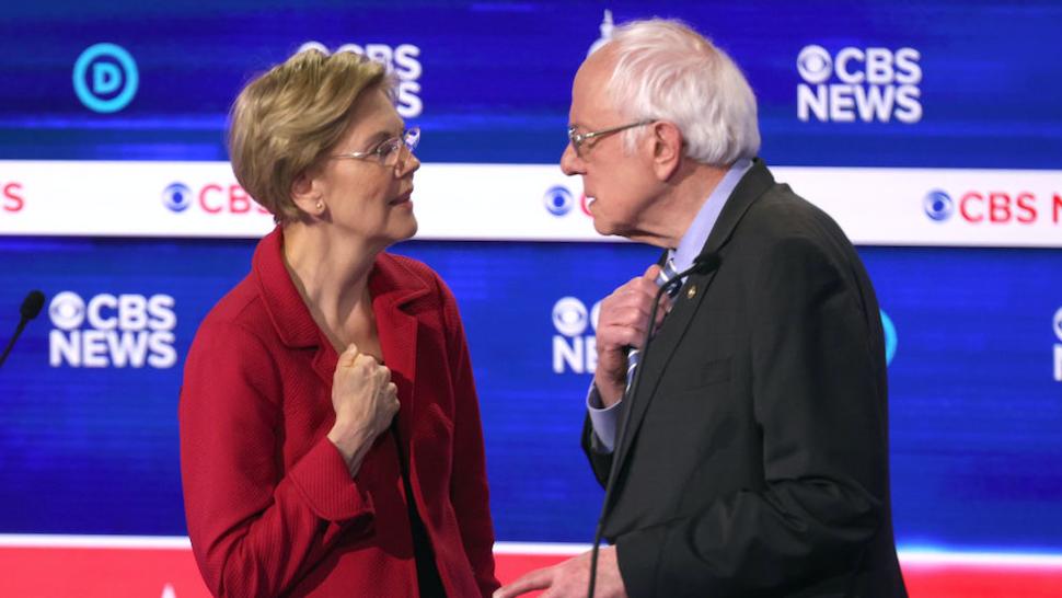 Democratic presidential candidates Sen. Elizabeth Warren (D-MA) (L) and Sen. Bernie Sanders (I-VT) interact during a break at the Democratic presidential primary debate at the Charleston Gaillard Center on February 25, 2020 in Charleston, South Carolina.