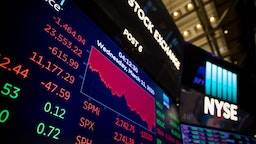 Screens show trading data at the New York Stock Exchange in New York, the United States, on March 11, 2020. The Dow Jones Industrial Average sank 1,464.94 points, or 5.86 percent, to 23,553.22. The 30-stock index fell into a bear market territory, down more than 20 percent from last month's record close. The S&P 500 decreased 140.85 points, or 4.89 percent, to finish at 2,741.38. The Nasdaq Composite Index dipped 392.20 points, or 4.70 percent, to 7,952.05. (Photo by Michael Nagle/Xinhua via Getty)