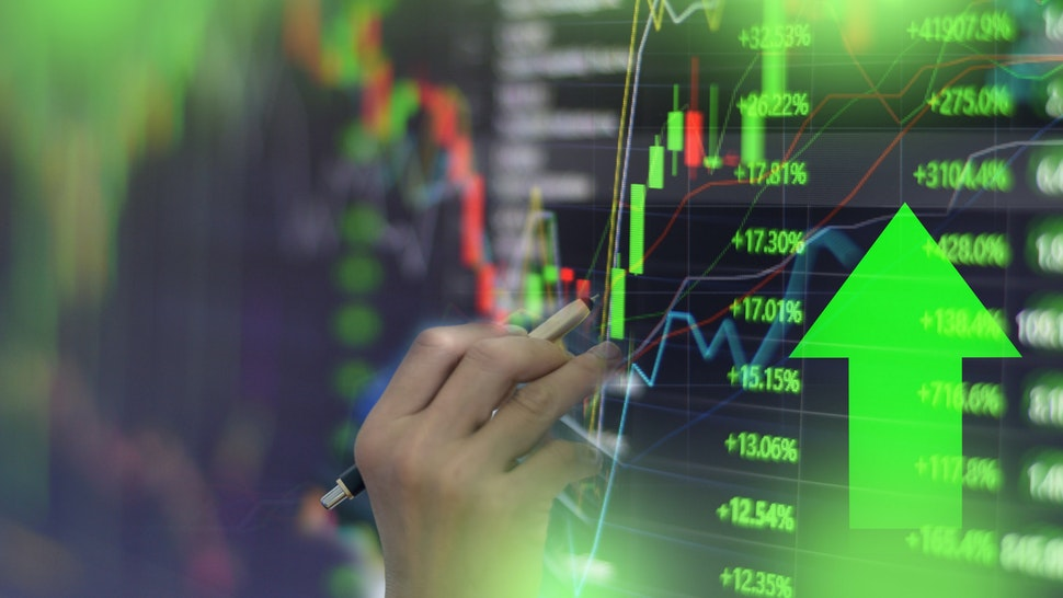 Green stock market graph chart with indicator investment trading stock exchange trading market monitor screen close up.