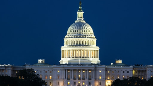 The United States Capitol Building at night.