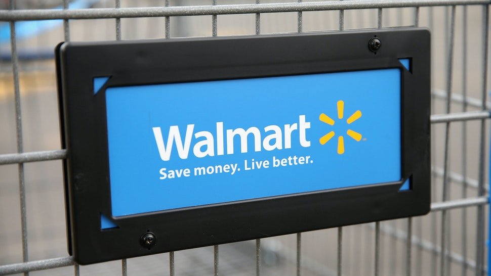 CHICAGO, IL - AUGUST 15: The Walmart logo is displayed on a shopping cart at a Walmart store on August 15, 2013 in Chicago, Illinois. Walmart, the world's largest retailer, reported a surprise decline in second-quarter same-store sales today. The retailer also cut its revenue and profit forecasts for the fiscal year.