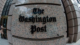 The building of the Washington Post newspaper headquarter is seen on K Street in Washington DC on May 16, 2019. - The Washington Post is a major American daily newspaper published in Washington, D.C., with a particular emphasis on national politics and the federal government. It has the largest circulation in the Washington metropolitan area. (Photo by Eric BARADAT / AFP)
