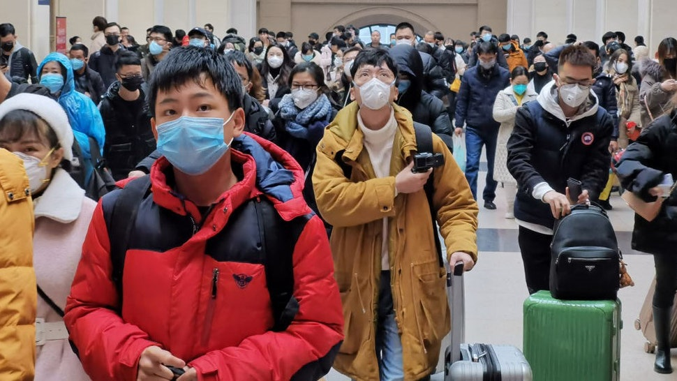 """WUHAN, CHINA - JANUARY 22: People wear face masks as they wait at Hankou Railway Station on January 22, 2020 in Wuhan, China. A new infectious coronavirus known as """"2019-nCoV"""" was discovered in Wuhan last week. Health officials stepped up efforts to contain the spread of the pneumonia-like disease which medical experts confirmed can be passed from human to human. Cases have been reported in other countries including the United States,Thailand, Japan, Taiwan, and South Korea. It is reported that Wuhan will suspend all public transportation at 10 AM on January 23, 2020."""