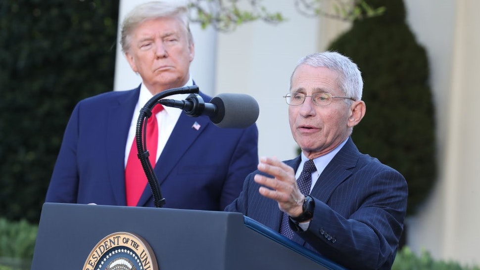 Anthony Fauci, director of the National Institute of Allergy and Infectious Diseases, right, speaks as U.S. President Donald Trump listens during a Coronavirus Task Force news conference in the Rose Garden of the White House in Washington, D.C., U.S., on Monday, March 30, 2020. Trump said he would now extend social distancing measures until at least April 30. Photographer