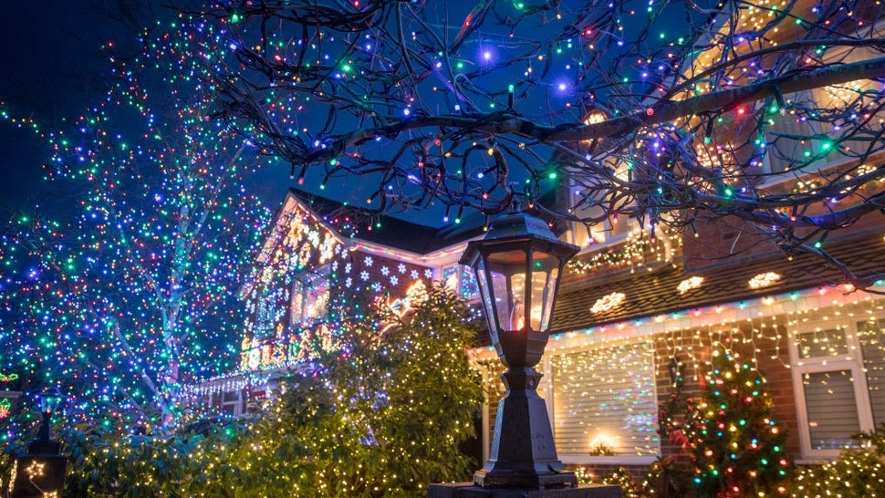 BURNHAM-ON-SEA, ENGLAND - DECEMBER 06: Christmas lights are displayed on houses in Trinity Close in Burnham-on-Sea on December 6, 2018 in Somerset, England. For over eleven years, the residents of Trinity Close, dubbed 'Britains most festive street have decorated their homes and gardens with more than a 100,000 colourful Christmas lights. Last year, the residents raised a record sum of £13,329 for local charities and since starting the festive display have raised over £85,000 for charitable causes. The display will be lit every night until early January. (Photo by