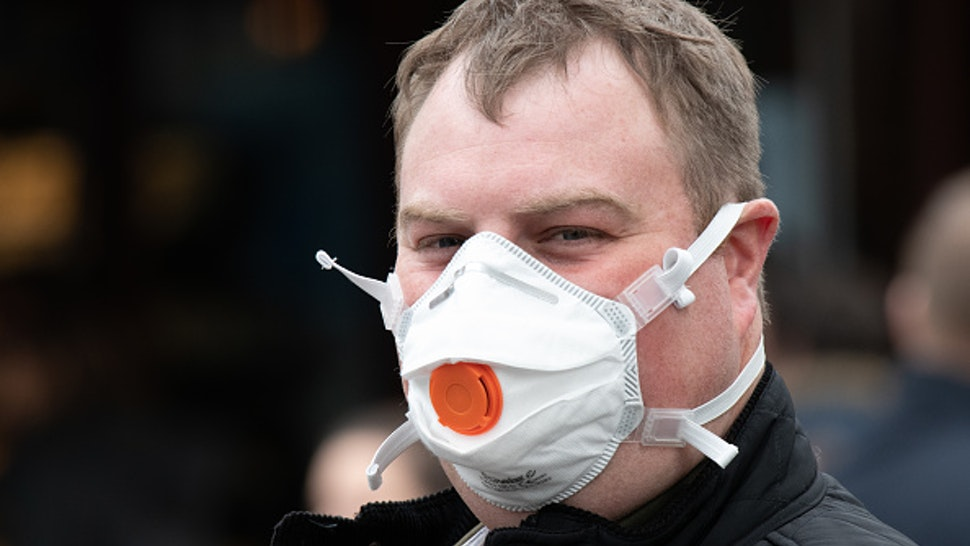 CARDIFF, UNITED KINGDOM - MARCH 14: A man wears a N95 protective respirator mask on March 14, 2020 in Cardiff, United Kingdom.