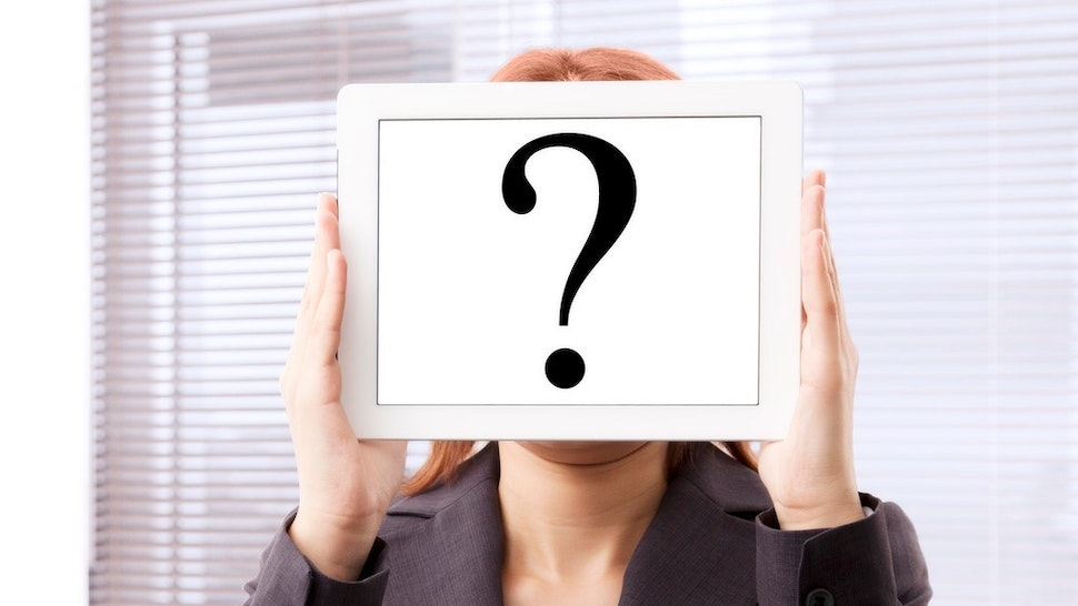 Businesswoman with question mark touchscreen tablet