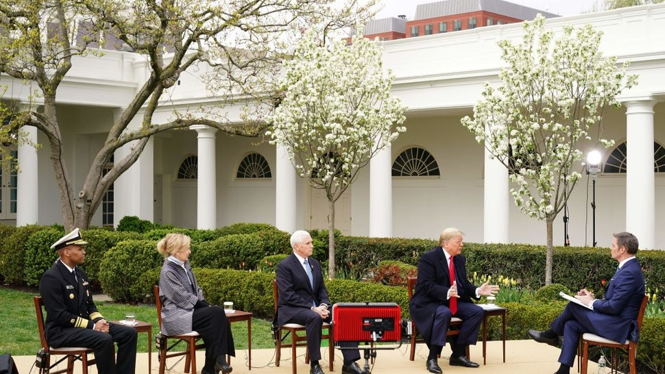 (L-R) US Surgeon General Jerome Adams, Response coordinator for White House Coronavirus Task Force Deborah Birx, US Vice President Mike Pence and President Donald Trump take part in a Fox News virtual town hall meeting with anchor Bill Hemmer, from the Rose Garden of the White House in Washington, DC, on March 24, 2020. (Photo by MANDEL NGAN / AFP) (Photo by