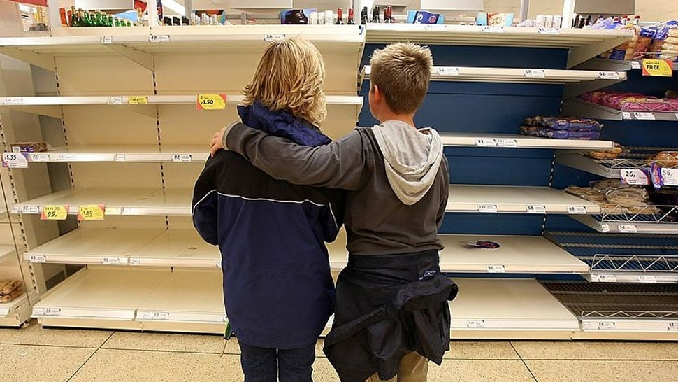 A mother and her son look at the empty bakery shelves in a supermarket on July 23 2007