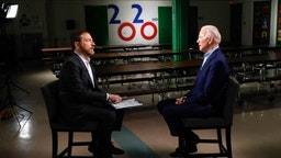 """MEET THE PRESS -- Pictured: (l-r) Moderator Chuck Todd and FMR VP. Joe Biden (D) appear in a pre-taped interview on ?Meet the Press"""" at O Knudson Middle School in Las Vegas, NV on Saturday, Feb. 15, 2020 - (Photo by:"""