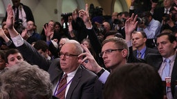WASHINGTON, DC - JANUARY 23: Members of the media raise their hands to ask questions during a daily briefing conducted by White House Press Secretary Sean Spicer at the James Brady Press Briefing Room of the White House January 23, 2017 in Washington, DC. Spicer conducted his first official White House daily briefing to take questions from the members of the White House press corps. (Photo by