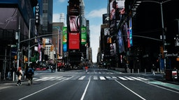 Times Square stands mostly empty as as much of the city is void of cars and pedestrians over fears of spreading the coronavirus on March 22, 2020 in New York City.