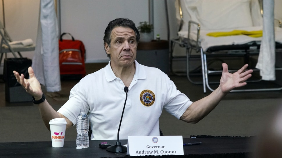 New York Gov Andrew Cuomo gives a daily coronavirus press conference in front of media and National Guard members at the Jacob K. Javits Convention Center, which is being turned into a hospital to help fight coronavirus cases on March 27, 2020 in New York City.